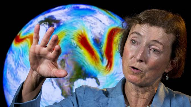 """Rutgers University Climate Scientist Jennifer Francis talks about the jet stream in front of an animation of the fast flowing air current during an interview in Washington, on Friday, June 7, 2013. """"It's been just a crazy fall and winter and spring all along, following a very abnormal sea ice condition in the Arctic,"""" Francis said, noting that last year set a record low for summer sea ice in the Arctic. """"It's possible what we're seeing in this unusual weather is all connected."""" (AP Photo/Jacquelyn Martin)"""
