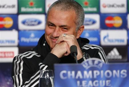 Chelsea manager Jose Mourinho smiles as he addresses a news conference in Basel November 25, 2013.