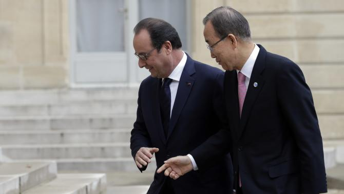 French President Francois Hollande welcomes United Nations Secretary General Ban Ki-moon at the Elysee Palace in Paris