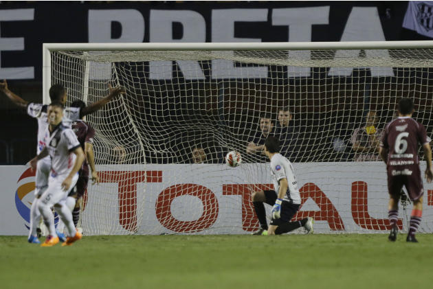 Agustin Marchesin, center, goalkeeper of Argentina's Lanus looks at the ball after Felipe Bastos, of Brazil's Ponte Preta score during the first leg match of Copa Sudamericana final in Sao Pau