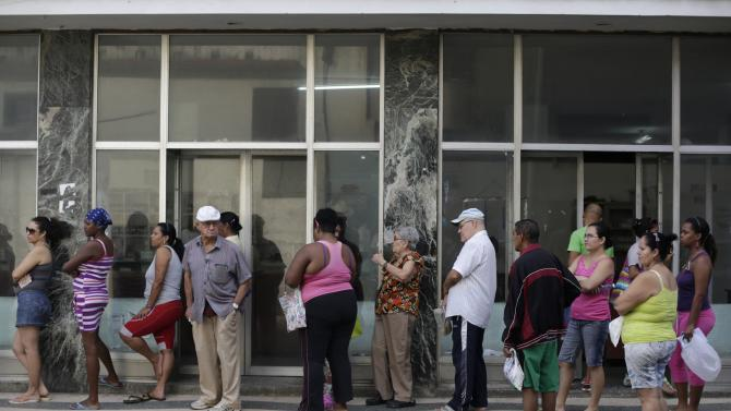 People line up outside a state pharmacy to buy medicine in Havana