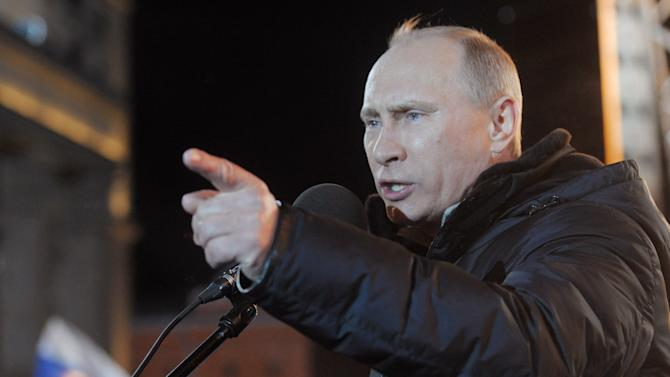 Russian Prime Minister Vladimir Putin,  who claimed victory in Russia's presidential election, speaks at a rally of his supporters at Manezh square outside Kremlin, in Moscow, Russia, Sunday, March 4, 2012. Vladimir Putin has claimed victory in Russia's presidential election, which the opposition and independent observers say has been marred by widespread violations. Putin made the claim at a rally of tens of thousands of his supporters just outside the Kremlin, thanking his supporters for helping foil foreign plots aimed to weaken the country.   (AP Photo/RIA-Novosti, Alexei Nikolsky, Government Press Service)