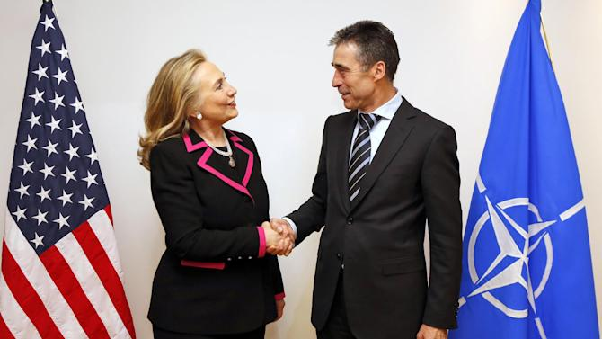 U.S. Secretary of State Hillary Rodham Clinton, left,  shakes hands with NATO Secretary-General Anders Fogh Rasmussen at the NATO headquarters in Brussels Tuesday Dec. 4, 2012.  (AP Photo / Kevin Lamarque)