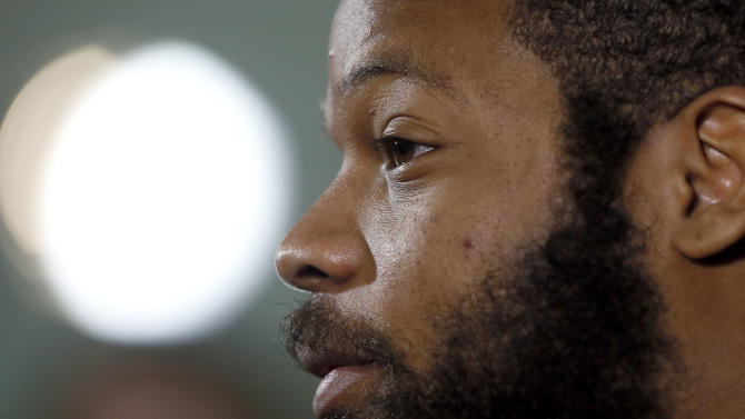 Seattle Seahawks' Michael Bennett answers a question during an interview for NFL Super Bowl XLIX football game, Thursday, Jan. 29, 2015, in Phoenix. The Seahawks play the New England Patriots in Super Bowl XLIX on Sunday, Feb. 1, 2015