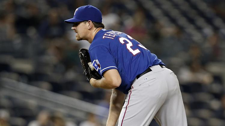 Texas Rangers starting pitcher Nick Tepesch sizes up a batter in the 14th inning of the Rangers 2-1 loss to the New York Yankees in a baseball game at Yankee Stadium in New York, Tuesday, July 22, 2014. Tepesch was the losing pitcher in the outing. (AP Photo)