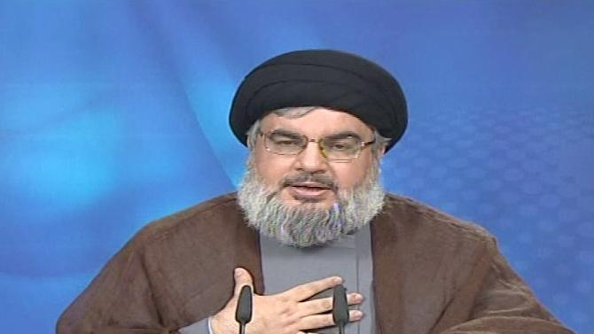 """This image taken from Al-Manar TV via Associated Press Television News shows Hezbollah leader Sheik Hassan Nasrallah making a broadcast during which he defended the men indicted in the murder of a former prime minister of Lebanon as """"brothers"""" with an """"honorable history."""" Sheik Hassan Nasrallah spoke Saturday July 2, 2011, for the first time since the indictment was announced Thursday. A high-ranking Hezbollah militant and three others were accused in the 2005 assassination of Rafik Hariri. (AP Photo/Al-Manar TV via APTN)"""