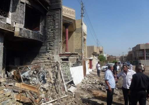 Iraqis inspect damage after multiple mortars struck the Chikuk neighbourhood in Baghdad on October 23. Shootings and bombings in Baghdad and north of the capital killed 11 people on Wednesday, including six government employees in a minibus on their way home, in the run-up to the Muslim Eid holiday