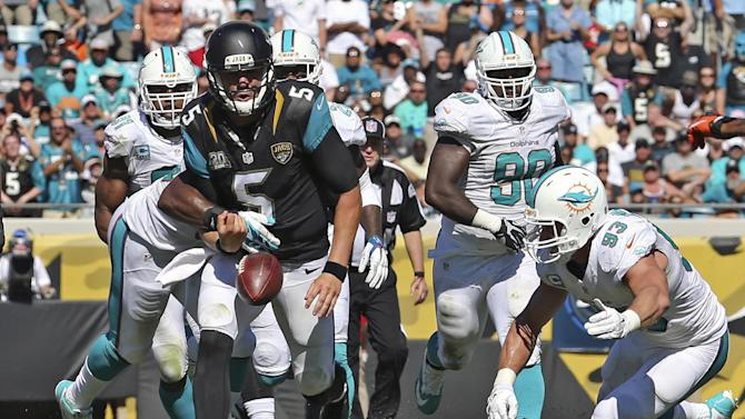 Dolphins use interception returns to beat Jaguars