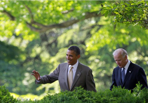 President Barack Obama and Vice President Joe Biden walk towards the Rose Garden of the White House for the ceremony honoring the 2012 National Association of Police Organizations TOP COPS award winne