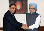 "Handout from Pakistan's Press Information Department (PID) shows Pakistan's President Asif Ali Zardari (left) shaking hands with Indian Prime Minister Manmohan Singh during a meeting in New Delhi. Zardari became the first Pakistani head of state since 2005 to visit India for a one-day trip he described as ""very fruitful"" in improving ties between the rivals"