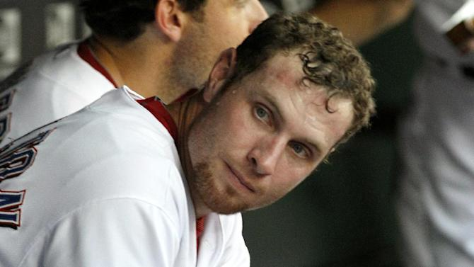 Texas Rangers center fielder Josh Hamilton sits in the dugout during the baseball game against the Minnesota Twins, Friday, July 6, 2012, in Arlington, Texas. (AP Photo/LM Otero)