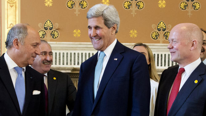French Foreign Minister Laurent Fabius, left, talks with U.S. Secretary of State John Kerry, and British Foreign Secretary William Hague as they gather for a group photo of the London 11 at the Foreign Office in London, Thursday, May 15, 2014. (AP Photo/Jacquelyn Martin, pool)