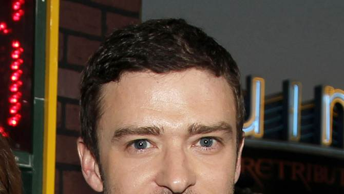 "FILE - This Sept. 19, 2012 file photo shows singer-actor Justin Timberlake at the premiere of ""Trouble With the Curve""  in Los Angeles. Timberlake released a lyric video of his hit single, ""Suit & Tie,"" featuring rapper Jay-Z. After the highly anticipated audio version dropped in mid-January 2013, the lyric video premiered nearly two weeks later on all of MTV's television networks and website. (Photo by Matt Sayles/Invision/AP, file)"