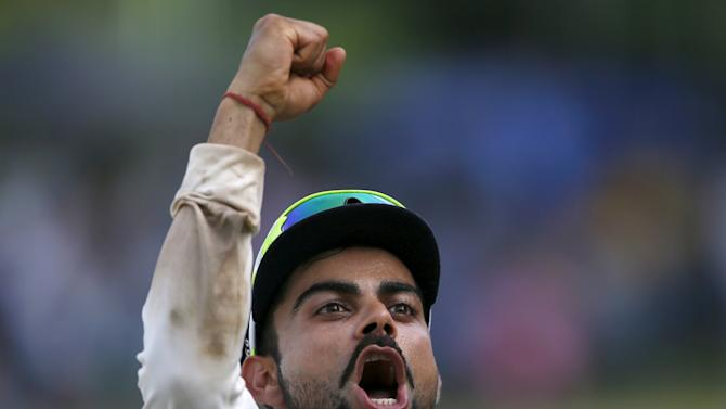 India's captain Kohli celebrates after they won their final test cricket match and the series against Sri Lanka in Colombo
