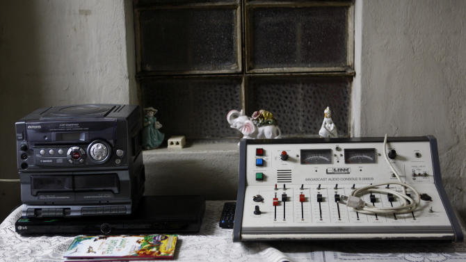 "In this Nov. 26, 2012 photo, a compact stereo system and a soundboard sit in the home of journalist and radio host Maria Julia Venegas, better known as Maruja Venegas, 97, in Lima, Peru. Venegas who began broadcasting ""Radio Club Infantil,"" a show for Peru's children in the golden age of radio and World War II, has earned a citation from Guinness World Records as the globe's longest-running radio personality. (AP Photo/Karel Navarro)"