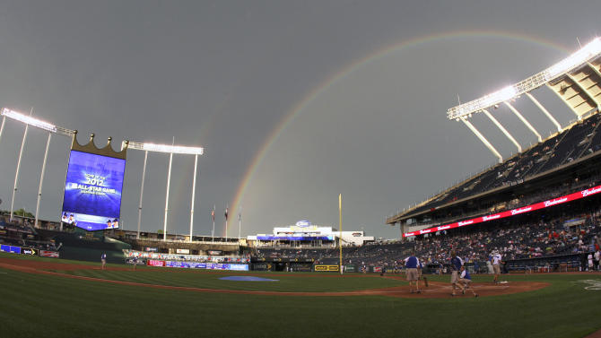 FILE - In this Wednesday, June 16, 2010, file photograph, a rainbow arches near Kauffman Stadium as the grounds crews prepare the field after a rain delay before a baseball game between the Kansas City Royals and the Houston Astros, in Kansas City, Mo. Kauffman Stadium recently underwent a $250 million renovation in part to lure the All-Star game back to Kansas City, and commissioner Bud Selig officially awarded the game on June 16, 2010. (AP Photo/Ed Zurga, File)