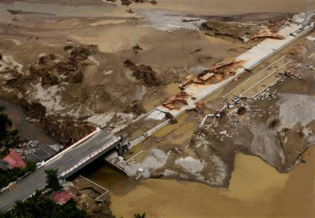 An aerial view shows a collapsed bridge on the outskirts of Acapulco