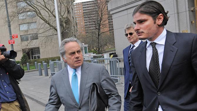 Hillel Nahmad, right, exits Manhattan federal court with his attorney Benjamin Brafman, Friday, April 19, 2013, in New York. Nearly three dozen people were charged on Tuesday in what investigators said was a Russian organized crime operation that included illegal, high-stakes poker games for the rich and famous and threats of violence to make sure customers paid their debts. (AP Photo/ Louis Lanzano)