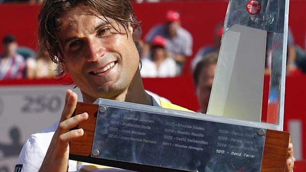 Spain's David Ferrer holds the trophy after winning the Buenos Aires Open