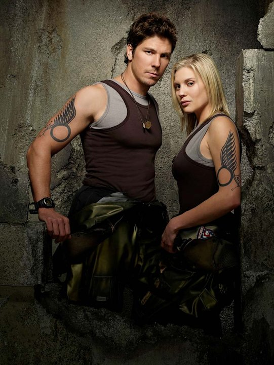 "Michael Trucco as Sam Anders and Katee Sackhoff as Kara ""Starbuck"" Thrace in Battlestar Galactica on the Sci Fi Channel."