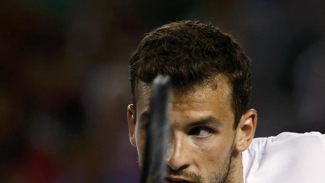 Grigor Dimitrov of Bulgaria hits a return against Andy Murray of Britain during their men's singles fourth round match at the Australian Open 2015 tennis tournament in Melbourne