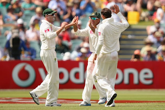 ADELAIDE, AUSTRALIA - NOVEMBER 23: Michael Hussey of Australia celebrates with team mates after running out Alviro Petersen of South Africa during day two of the Second Test match between Australia an