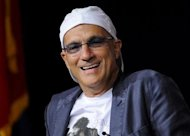 Chairman of Interscope Geffen A&M Jimmy Iovine reacts to a question during the University of Southern California&#39;s Schwarzenegger Institute for State and Global Policy inaugural Symposium in Los Angeles California, September 24, 2012. REUTERS/Gus Ruelas/Files