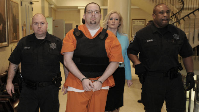 Jacob Shaffer is escorted to court Friday, March 8, 2013 in Huntsville, Ala. Shaffer, who pleaded guilty to killing five people in Tennessee, pleaded guilty Friday to killing a sixth person in north Alabama. Shaffer admitted to killing Sidney Wade Dempsey in Huntsville in 2009. The 33-year-old Shaffer reached plea deals that allow him to avoid possible death sentences in all six murders.  (AP Photo/Eric Schultz, AL.com)