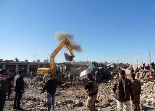 Men inspect the site of an explosion in Kirkuk, 240 kilometres north of the Iraqi capital Baghdad, on January 16, 2013