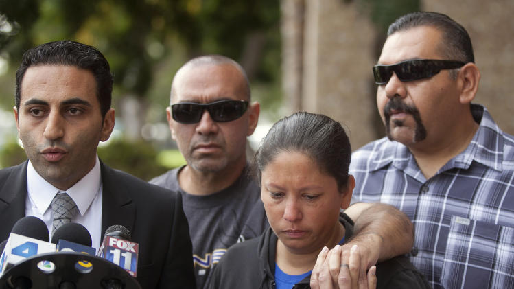 Victim's family attorney, Kevin Danesh, far left, and victim's brothers: Ruben Moreno with his wife, Heather, and Daniel Moreno, right, talk to news media outside court in Torrance, Calif., Tuesday, Nov. 27, 2012. Victim, 31-year-old Phillip Moreno was struck late Saturday by a car driven by a drunken substance abuse counselor. Los Angeles County prosecutors have filed murder and drunken-driving charges against Sherri Wilkins, who struck Moreno and drove for more than two miles with the dying victim on the hood of her car. Moreno later died at a hospital. (AP Photo/Damian Dovarganes)