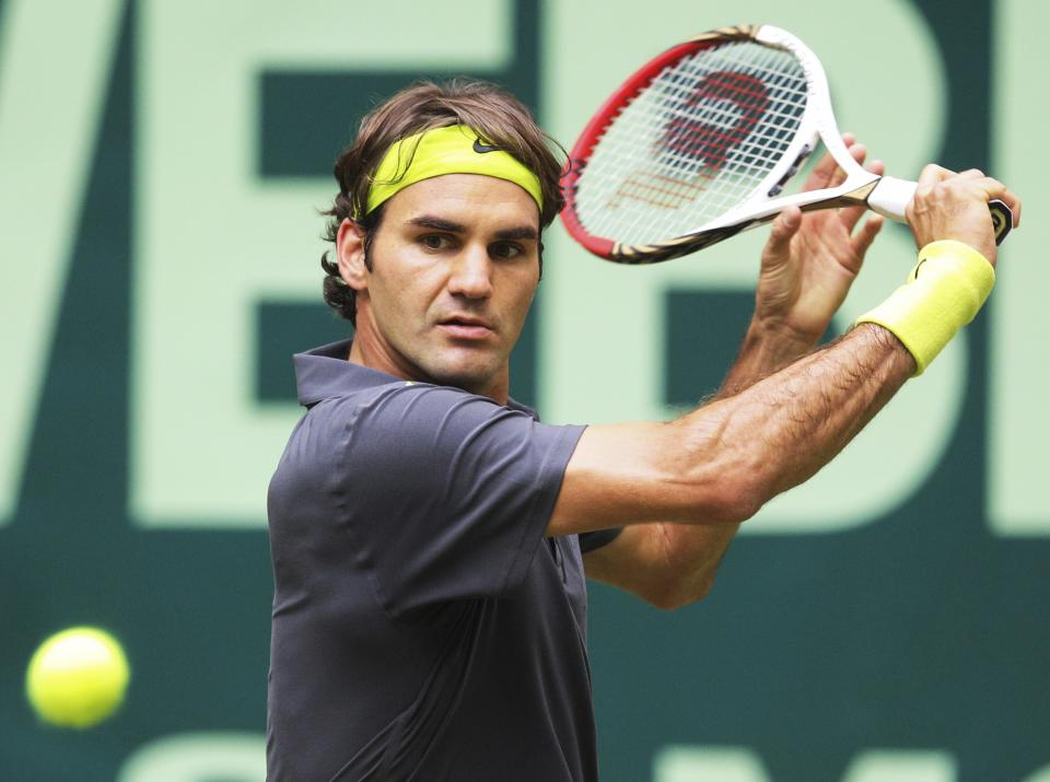 Switzerland 's  Roger Federer  returns a ball during his  semifinal match against Mikhail Youzhny  from Russia at the Gerry Weber Open ATP  tennis tournament in Halle, western Germany, Saturday June 16, 2012.  Federer won by 6-1 and 6-3. (AP Photo/dapd/Joerg Sarbach)