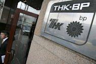 A man exits the offices of British-Russian oil giant TNK-BP in central Moscow on March 19, 2008. British energy giant BP said Tuesday that net profits slumped by more than half in 2012, as the group was rocked by fines and asset sales linked to the 2010 Gulf of Mexico oil spill disaster, ahead of a US trial later this month
