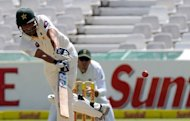 Pakistan cricketer Misbah-ul-Haq plays a shot before being dismissed for 0 on the first day of the second Test against South Africa at Newlands in Cape Town on February 14, 2013. Centuries by Younis Khan and Asad Shafiq transformed Pakistan&#39;s fortunes on the first day of the second Test on Thursday