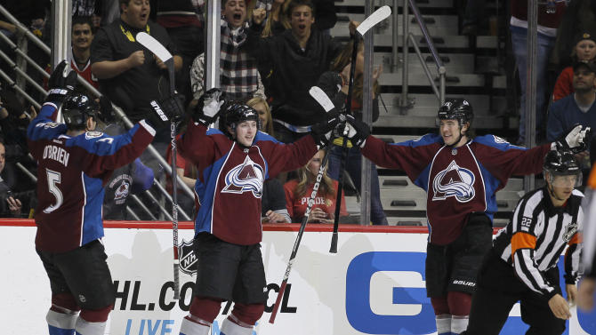 Colorado Avalanche center Matt Duchene, center, celebrates after scoring a goal with defenseman Shane O'Brien, left, and right wing PA Parenteau against the Chicago Blackhawks in the second period of an NHL hockey game in Denver, Friday, March 8, 2013. (AP Photo/David Zalubowski)