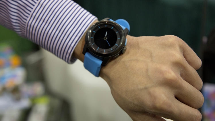The Cookoo watch is modeled at the Consumer Electronics Show, Wednesday, Jan. 9, 2013, in Las Vegas. The watch allows users to stay connected with their mobile devices alerting them of incoming calls, emails or text messages. (AP Photo/Julie Jacobson)