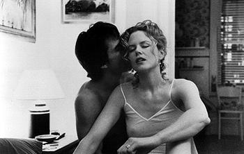 Dr. William Harford ( Tom Cruise ) and Alice Harford ( Nicole Kidman ) in Stanley Kubrick 's Eyes Wide Shut , from Warner Bros.