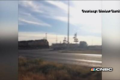 Truck on train tracks smashed to smithereens