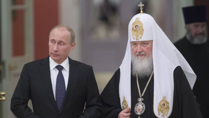 File photo of Russia's President Vladimir Putin and Patriarch of Moscow and All Russia Kirill arriving for the meeting with Russian Orthodox church bishops in Moscow