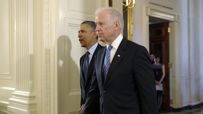 President Barack Obama and Vice President Joe Biden arrive for an Easter Prayer Breakfast in the East Room of the White House in Washington, Friday, April 5, 2013. (AP Photo/Susan Walsh)