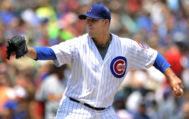 Chicago Cubs starter Paul Maholm delivers a pitch against the St. Louis Cardinals in the first inning during a baseball game in Chicago, Sunday, July 29, 2012. (AP Photo/Paul Beaty)