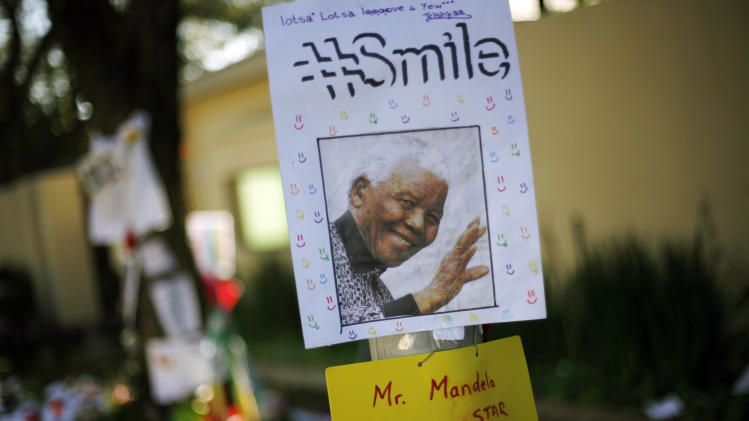 Get well soon messages and drawings are seen outside Nelson Mandela's house in Johannesburg, South Africa, Monday, July 1, 2013. Former president Nelson Mandela remained in a critical condition at the Medi-Clinic Heart Hospital in Pretoria on Monday . (AP Photo/Jerome Delay)