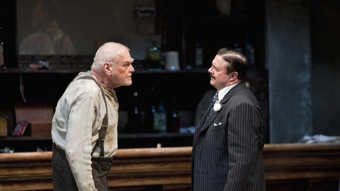 "In this April 20, 2012, production photo provided by the Goodman Theatre in Chicago, actors Brian Dennehy, left, portraying one-time syndicalist-anarchist Larry Slade and Nathan Lane as Theodore ""Hickey"" Hickman perform in a scene in Eugene O'Neill's ""The Iceman Cometh."" The Brooklyn Academy of Music said Tuesday the pair will present the five-hour work for a six-week run in the BAM Harvey Theater from Feb. 5 through March 15. (AP Photo/Courtesy of The Goodman Theatre, Liz Lauren)"