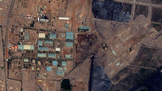 """The Yarmouk military complex in Khartoum, Sudan seen in a satellite image made on October 12 2012, prior to the alleged attack. A U.S. monitoring group says satellite images of the aftermath of an explosion at a Sudanese weapons factory suggest the site was hit by an airstrike. The Sudanese government has accused Israel of bombing its Yarmouk military complex in Khartoum, killing two people and leaving the factory in ruins.The images released by the Satellite Sentinel Project to The Associated Press on Saturday Oct 27 2012 showed several 52-foot wide craters. A spokesman for the project said military experts found the craters to be """"consistent with large impact craters created by air-delivered munitions."""" Israeli officials have neither confirmed nor denied striking the site, instead accusing Sudan of playing a role in an Iranian-backed network of arms shipments to Hamas and Hezbollah.  (AP Photo/ DigitalGlobe via Satellite Sentinel Project)"""