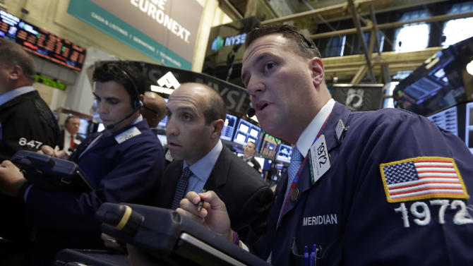 Trader James Denaro, center, and Jonathan Corpina, right, work on the floor of the New York Stock Exchange Wednesday, April 24, 2013. World stocks were mostly higher Thursday April 25, 2013 as a slump in orders for U.S. durable goods and other data convinced investors that central banks would continue efforts to help the global economic recovery.  (AP Photo/Richard Drew)