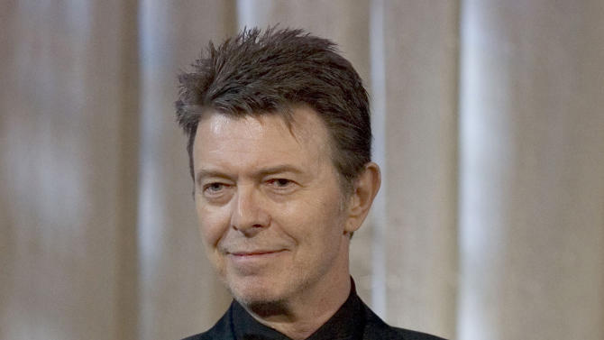 "FILE - David Bowie attends an awards show in this June 5, 2007 file photo taken in New York. The English singer announced Tuesday,  Jan. 8, 2013 his 66th birthday, that he has released his first song in 10 years titled ""Where Are We Now?"" A new album, ""The Next Day,"" will be out March 11 and 12 in the United Kingdom and the United States, respectively. (AP Photo/Stephen Chernin)"