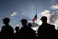 US Army soldiers stand attend the memorial service in honor of the 13 victims of the shooting rampage by US Army Major Nidal Malik Hasan, on November 10, 2009 in Fort Hood, Texas