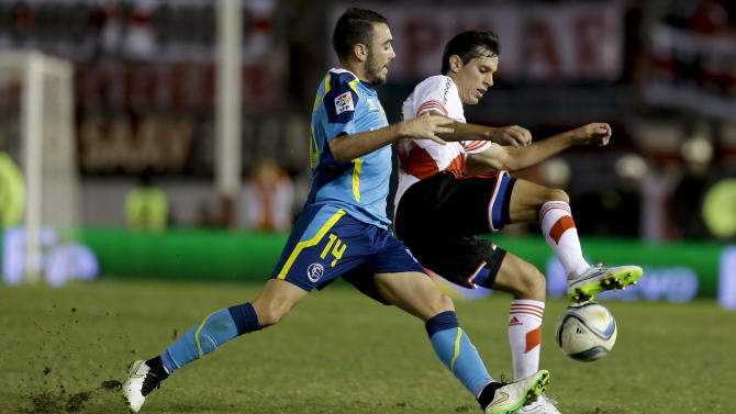 Augusto Solari of Argentina's River Plate, right, fights for the ball with Iago Aspas of Spain's Sevilla, during the Supercopa Euroamericana friendly soccer match in Buenos Aires, Argentina, Thursday, March 26, 2015.(AP Photo/Natacha Pisarenko)