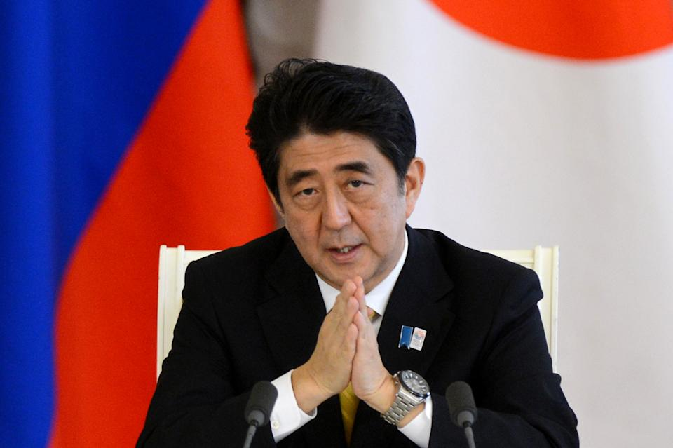 Japanese Prime Minister Shinzo Abe speaks at a news conference in Moscow's Kremlin on Monday, April 29, 2013. Abe is in Russia on an official visit (AP Photo/Kiril Kudryavtsev, pool)