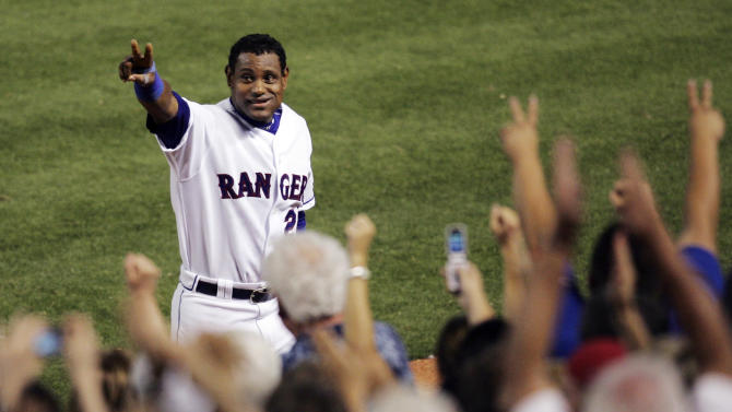 FILE - In this June 20, 2007, file photo, Texas Rangers' Sammy Sosa acknowledges cheers from fans after hitting his 600th career home run against the Chicago Cubs in a baseball game in Arlington, Texas. Sosa, Roger Clemens and Barry Bonds are set to show up on the Hall of Fame ballot for the first time on Wednesday, Nov. 28, 2012, and fans will soon find out whether drug allegations block the former stars from reaching baseball's shrine. (AP Photo/Tim Sharp, File)