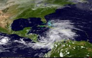 The GOES East satellite captured this view of Tropical Storm Sandy over the Caribbean Sea on Oct. 23, 2012, as it headed towards a strike on Jamaica.